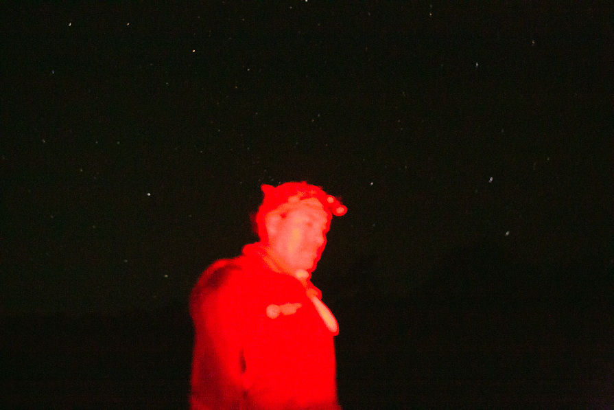 Urbano Huaman turns off his light and encourages the kids to be silent and take in the night sky.