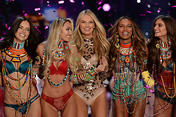 Candice Swanepoel (second left), Adriana Lima (left), Taylor Hill (right), Romee Strijd  (centre) and Jasmine Tookes (second right) on the catwalk for the Victoria's Secret Fashion Show at the Mercedes-Benz Arena in Shanghai, China