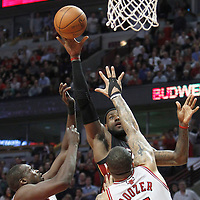 14 March 2012: `Miami Heat small forward LeBron James (6) scores against Chicago Bulls small forward Luol Deng (9) and Chicago Bulls power forward Carlos Boozer (5) during the Chicago Bulls 106-102 victory over the Miami Heat at the United Center, Chicago, Illinois, USA.