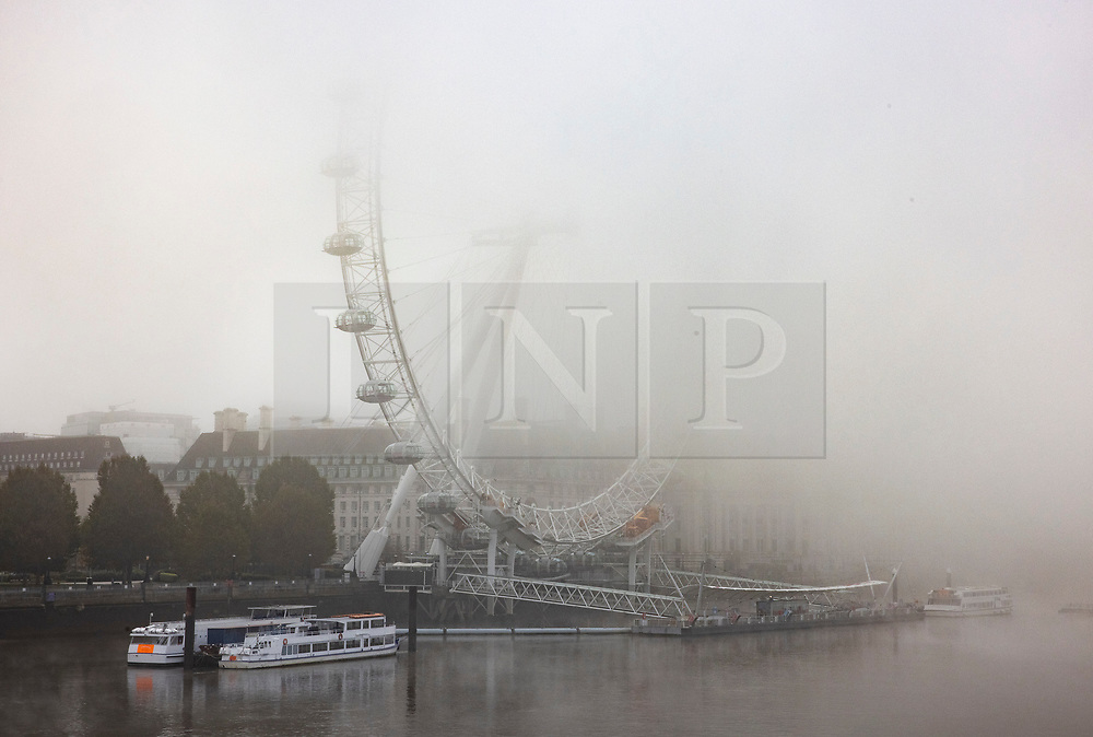 © Licensed to London News Pictures. 05/11/2020. London, UK. The London Eye ferris wheel in central London is shrouded in fog on the first day of England's national lockdown. Photo credit: London News Pictures