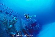 diver swims over deck of wreck of Russian missle frigate, Destroyer 356, renamed MV Capt. Keith Tibbits,<br /> Cayman Brac ( Caribbean Sea )   MR 282