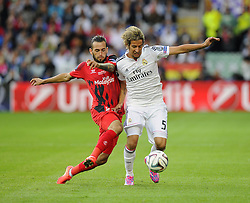 Real Madrid's Fabio Coentrao battles for the ball with Sevilla's Alexis Vidal Parreu  - Photo mandatory by-line: Joe Meredith/JMP - Mobile: 07966 386802 12/08/2014 - SPORT - FOOTBALL - Cardiff - Cardiff City Stadium - Real Madrid v Sevilla - UEFA Super Cup