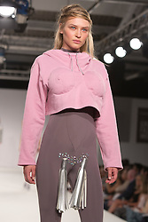© Licensed to London News Pictures. 01/06/2014. London, England. Collection by Louise Brooks from UCA Epsom Fashion - university for the creative arts. Graduate Fashion Week 2014, Runway Show at the Old Truman Brewery in London, United Kingdom. Photo credit: Bettina Strenske/LNP