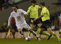 Photo: Olly Greenwood.<br />Tottenham Hotspur v FC Braga. UEFA Cup. 14/03/2007. Spurs Dimitar Berbatov goes past Braga'a Luis Filipe and Paulo Jorge