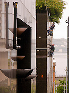 Window Cleaners on the side of a building in downtown Seattle, WA, USA