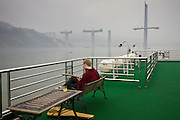 Tourist plays guitar on deck of Victoria Line Cruise Ship, Yangtze River, China