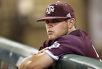 Texas A&M's Cole Bedford (54) watches as TCU celebrated their 8-2 win in a NCAA college baseball super regional tournament game, Friday, June 10, 2016, in College Station, Texas. (AP Photo/Sam Craft)