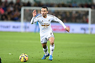 Leon Britton of Swansea city in action. Barclays Premier league match, Swansea city v Queens Park Rangers at the Liberty stadium in Swansea, South Wales on Tuesday 2nd December 2014<br /> pic by Andrew Orchard, Andrew Orchard sports photography.