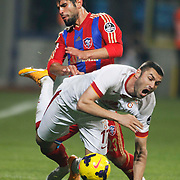 Kardemir Karabukspor's Tanju Kayhan (B) and Galatasaray's Burak Yilmaz (F) during their Turkish superleague soccer match Kardemir Karabukspor between Galatasaray Dr. Necmettin Seyhoglu stadium in Karabuk Turkey on Saturday 08 November 2014. Photo by Kurtulus YILMAZ/TURKPIX