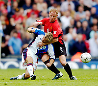 Photo. Jed Wee, Digitalsport<br /> NORWAY ONLY<br /> <br /> Blackburn Rovers v Manchester United, FA Barclaycard Premiership, 01/05/2004.<br /> Blackburn's Michael Gray (L) is wrestled to the ground by Manchester United's Nicky Butt.