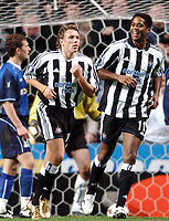 Fotball<br /> UEFA Cup 2004/2005<br /> Foto: BPI/Digitalsport<br /> NORWAY ONLY<br /> 04.11.2004<br /> <br /> Newcastle v Dinamo Tblisi<br /> <br /> Graig Bellamy trots back to the centre circle with a smiling Patrick Kluivert after he made it 2-0
