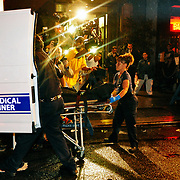 Medical examiners remove the body of Dj Am late Friday evening from his Manhattan Soho apartment.