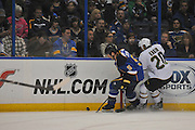 St. Louis Blues defenseman Barret Jackman (5) and Dallas Stars center Cody Eakin (20) go for the puck in first period action during a game between the Dallas Stars and the St. Louis Blues on Friday April 19, 2013 at the Scottrade Center in downtown St. Louis.