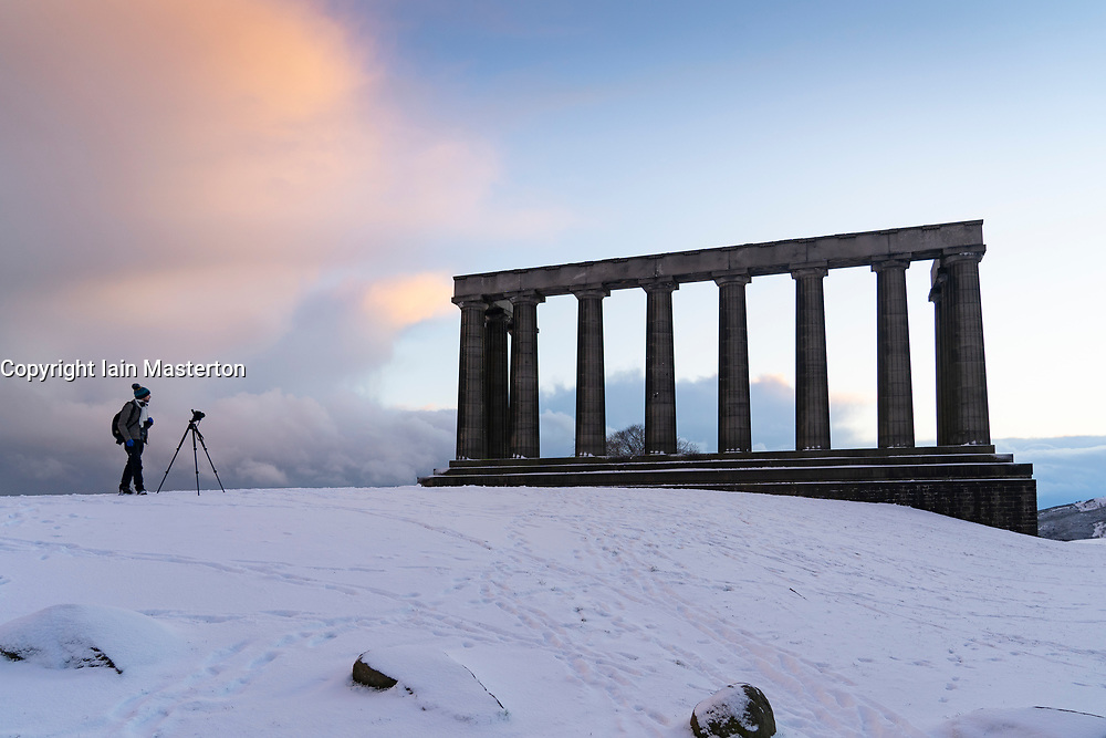 Edinburgh, Scotland, UK. 9 Feb 2021. Big freeze continues in the UK with Storm Darcy bringing several inches of snow to Edinburgh overnight. Pic; Photographer on Calton Hill. Iain Masterton/Alamy Live news