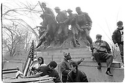 guardian Angel Curtis Sliwa jumps off a monument to World War 1 soldiers at a Fifth Ave demonstration against Serbian aggression on Feb 16. New York. 1993. © Copyright Photograph by Dafydd Jones 66 Stockwell Park Rd. London SW9 0DA Tel 020 7733 0108 www.dafjones.com