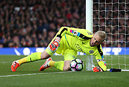Leicester's Kasper Schmeichel makes a save but the ball goes over the line during the Premier League match at the Emirates Stadium, London. Picture date: April 26th, 2017. Pic credit should read: David Klein/Sportimage
