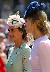 Pippa Middleton leaves St George's Chapel at Windsor Castle after the wedding of Meghan Markle and Prince Harry.