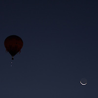 A sliver of moonlight in the still pre dawn sky makes for an the ideal Hot Air Balloon launch