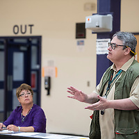 City Councilor Fran Palochak, left, listens to Public Works Director Stan Henderson, right, respond to residents questions during a neighborhood meeting Thursday, April 11, at Tobe Turpen Elementary School.