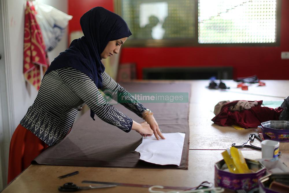 August 29, 2017 - Gaza, gaza strip, Palestine - A Palestinian fashion designer working in her shop in Gaza City on August 29, 2017. (Credit Image: © Majdi Fathi/NurPhoto via ZUMA Press)