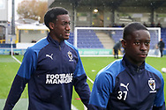 AFC Wimbledon attacker Zach Robinson (29) walking onto the pitch to warm up during the The FA Cup match between AFC Wimbledon and Doncaster Rovers at the Cherry Red Records Stadium, Kingston, England on 9 November 2019.