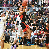 Gallup Bengal Quinn Atazhoon (24) drives to the basket against the Miyamura Patriots Friday night at Miyamura High School in Gallup. Gallup took the win 76-46.