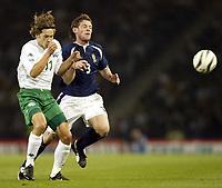 Photo Aidan Ellis.<br /> Scotland v Slovenia.<br /> 2006 FIFA World Cup Qualifier.<br /> Hampden Park Glasgow.<br /> 08/09/2004.<br /> Scotland's Gary Naysmith and Slovenia's Andrej Komac collide<br /> <br /> NORWAY ONLY