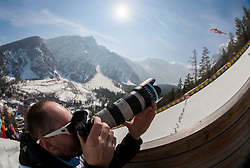 Photographer Grega Valancic of Sportida Photo Agency taking pictures during the Flying Hill Team Event at 3rd day of FIS Ski Jumping World Cup Finals Planica 2013, on March 23, 2013, in Planica, Slovenia. (Photo by Vid Ponikvar / Sportida.com)