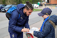 AFC Wimbledon defender Nesta Guinness-Walker (18) signing autographs during the EFL Sky Bet League 1 match between AFC Wimbledon and Bolton Wanderers at the Cherry Red Records Stadium, Kingston, England on 7 March 2020.
