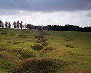 Remains of WW1 shell craters and German trenches at the Beaumont-Hamel battlefield memorial, France. The site is dedicated Newfoundland forces members who were killed during World War I. The 74-acre (300,000 m2) preserved battlefield park encompasses the grounds over which the Newfoundland Regiment made their unsuccessful attack on 1 July 1916 during the first day of the Battle of the Somme. During the First World War, Beaumont-Hamel was very close to the front lines of the conflict and saw heavy combat, especially during the Battle of the Somme which was the largest Allied offensive of the entire war. Beaumont-Hamel is a commune in the Somme department in Picardy in northern France.