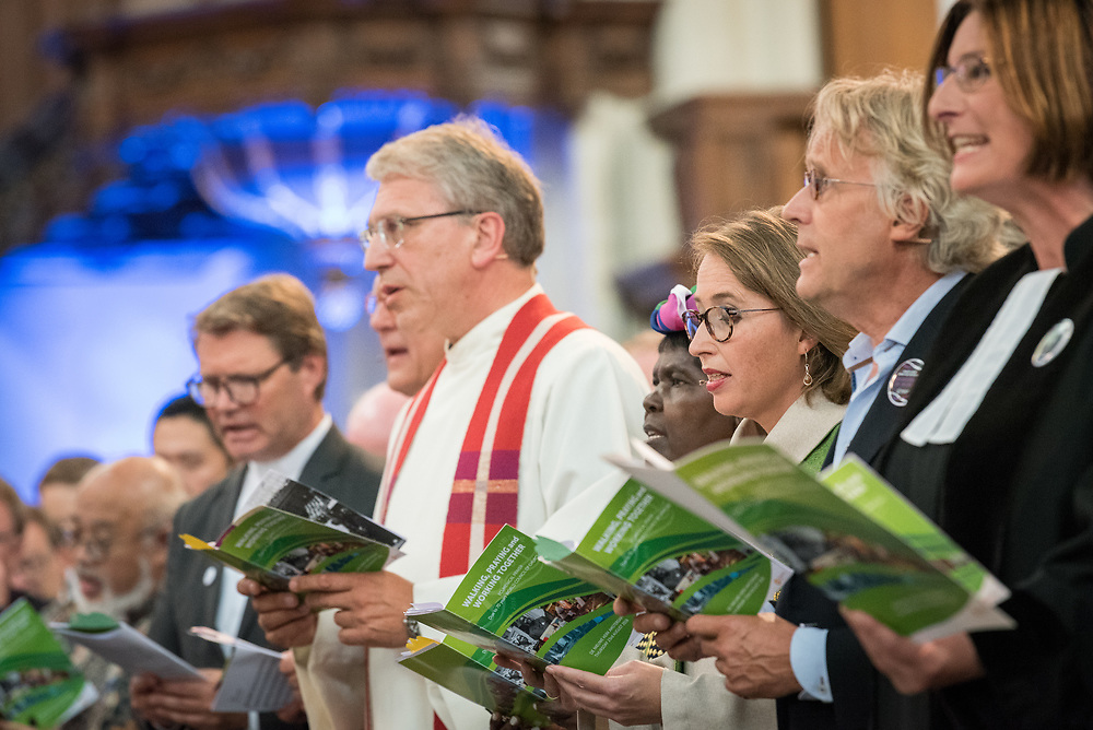 23 August 2018, Amsterdam, Netherlands: Hundreds of people gather from across the world for an ecumenical prayer service at the Nieuwe Kerk, a 15th-century church in Amsterdam, to celebrate the 70th anniversary of the World Council of Churches at the very spot in which the organization was founded. Under the theme ìWalking, Praying and Working Together,î pilgrims from all over the world attend the service.