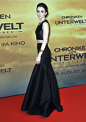 Lily Collins arrives for the 'The Mortal Instruments: City of Bones' Germany premiere at Sony Centre on Tuesday August 20, 2013 in Berlin, Germany. Photo by Schneider-Press / John Farr / i-Images. <br /> UK & USA ONLY