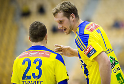 Miha Zarabec of RK Celje PL vs Povilas Babarskas of RK Celje PL during handball match between RK Celje Pivovarna Lasko and RK Gorenje Velenje in Eighth Final Round of Slovenian Cup 2015/16, on December 10, 2015 in Arena Zlatorog, Celje, Slovenia. Photo by Vid Ponikvar / Sportida