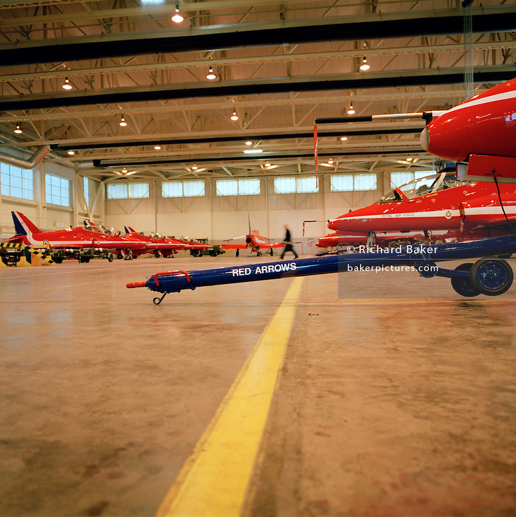 Towing bars on the ground in the hangar of the Red Arrows, Britain's RAF aerobatic team.