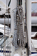A bundle of ropes on the main mast of a yacht