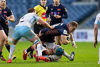 Rugby Union - 2020 / 2021 Guinness Pro-14 - Edinburgh vs Glasgow Warriors - Murrayfield<br /> <br /> Duhan van der Merwe of Edinburgh Rugby is tackled by Scott Cummings of Glasgow Warriors<br /> <br /> COLORSPORT/BRUCE WHITE