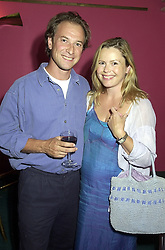 TV presenter LIZ EARLE and her husband MR PATRICK DRUMMOND, at a reception in London on 21st August 2000.OGS 8