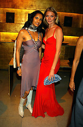 Left to right, PADMA LAKSHMI and JODIE KIDD  at a party to celebrate the first 20 years of fashion label Donna Karan held at her store at 19/20 New Bond Street, London W1 on 21st September 2004.<br />