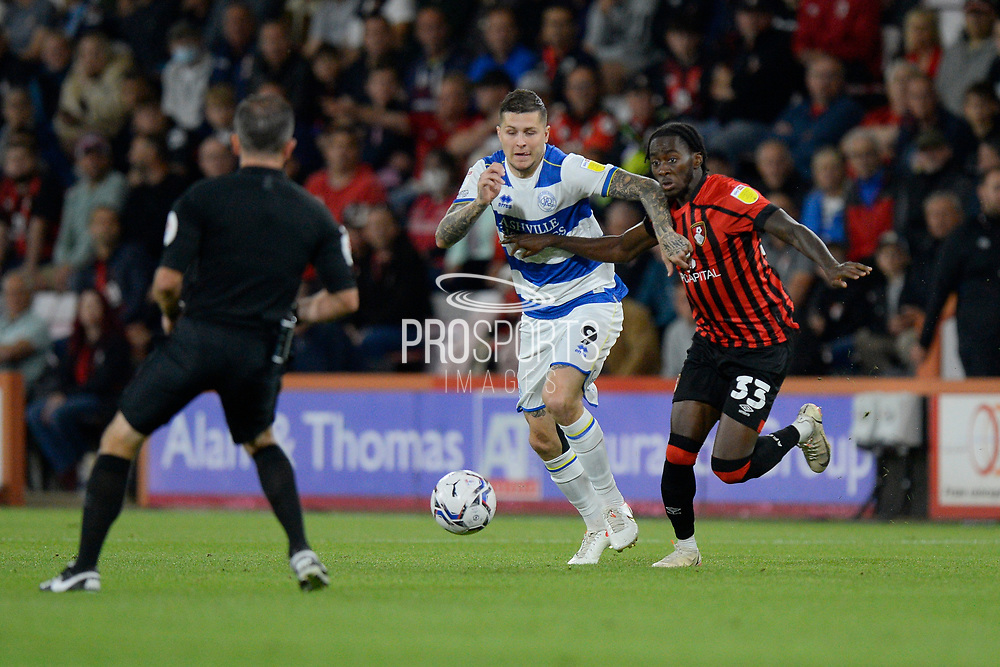 Lyndon Dykes (9) of Queens Park Rangers battles for possession with Jordan Zemura (33) of AFC Bournemouth during the EFL Sky Bet Championship match between Bournemouth and Queens Park Rangers at the Vitality Stadium, Bournemouth, England on 14 September 2021.