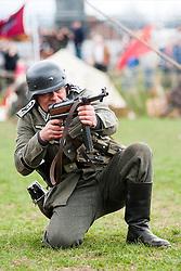 Reeactor portraying Stabsfelwebel from Infantry Regiment Grossdeutschland using a blank firing MP40 Sub Machine Gun.21 April  2013.Image © Paul David Drabble