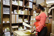 The pharmacy administrator checks stocks of drugs in the pharmacy's storage room at the Koumassi General Hospital in Abidjan, Cote d'Ivoire on Friday July 19, 2013.