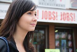 Young Czech woman outside recruitment agency,