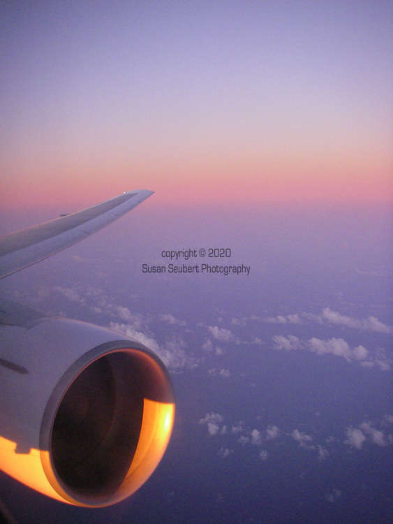 View from an airplane window at dusk