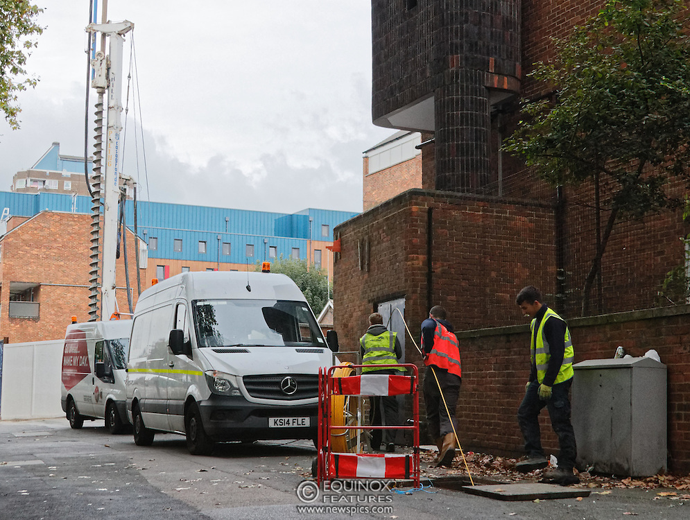 London, United Kingdom - 10 October 2015<br /> Huge drill cuts Virgin fiber cable. Thousand customers without weekend TV and internet. Severed fiber optic cables have caused up to a thousand customers of Virgin Media in Shoreditch and Hackney in London to be left without broadband internet and cable television this weekend. Engineers believe the total loss of service, which continues to be down this Saturday evening, is unlikely to be fixed until Sunday lunchtime at the earliest. The damage to a primary cable carrying 96 fiber optic cables including some belonging to the EE mobile network was caused by a huge drilling rig on a nearby construction site for a block of flats being built by Formation Construction Ltd. An engineer working on the drilling site claimed they had not 'drilled through the cable'. 'We damaged the cable' he said. He then demanded we delete images of the offending drilling rig. Technicians working on behalf of Virgin Media were working hard to replace the damaged cables. Virgin Media press office did not respond to repeated requests to speak with them for comment today.<br /> (photo by: EQUINOXFEATURES.COM)<br /> <br /> Picture Data:<br /> Photographer: Equinox Features<br /> Copyright: ©2015 Equinox Licensing Ltd. +448700 780000<br /> Contact: Equinox Features<br /> Date Taken: 20151010<br /> Time Taken: 17452623<br /> www.newspics.com