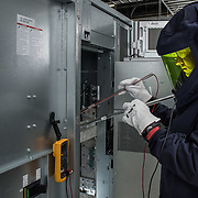 Schneider Electric engineer working on live equipment with  Safety PPE