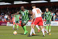 Bayo Akinfenwa forward for AFC Wimbledon (10) holds the ball up during the Sky Bet League 2 match between Stevenage and AFC Wimbledon at the Lamex Stadium, Stevenage, England on 30 April 2016. Photo by Stuart Butcher.