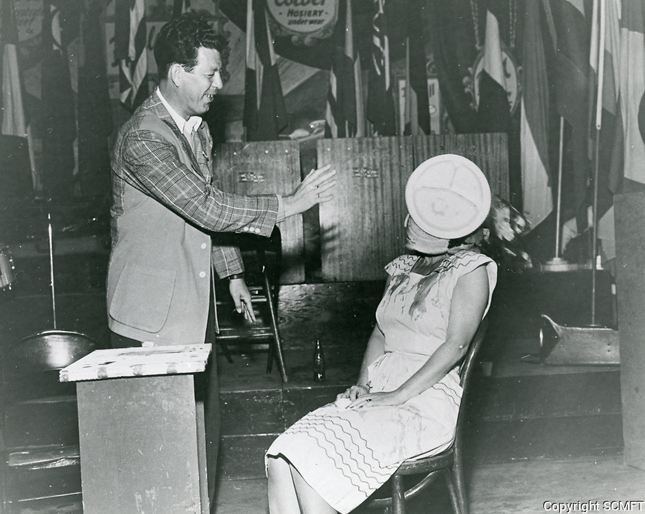1944 Hollywood Canteen co-founder, Bette Davis, takes a pie in the face during a skit on the Canteen's stage.