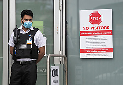 © Licensed to London News Pictures. 02/04/2020. London, UK. A police officer stands on guard outside the Clinical Decisions Unit (CDU) at The Royal London Hospital in East London, during a pandemic outbreak of the Coronavirus COVID-19 disease. Members of the public have been told they can only leave their homes when absolutely essential, in an attempt to fight the spread of COVID-19. Photo credit: Ben Cawthra/LNP