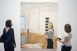 """© Licensed to London News Pictures. 28/11/2019. LONDON, UK. Staff members view """"It Is Enough I'm Delighted, Don't Make Me Understand It"""", 2019, by Marcin Maciejowski.  First look of """"Private View"""" by Polish artist Marcin Maciejowski at Galerie Thaddeus Ropac in Mayfair.  The artist's first London exhibition features new large-scale paintings and graphic works on paper merging comic-book and Old Master traditions.  The show runs 28 November to 25 January 2020. Photo credit: Stephen Chung/LNP"""