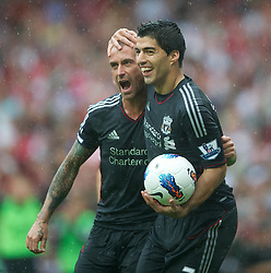 20.08.2011, Emirates Stadium, London, ENG, PL, FC Arsenal vs Liverpool FC, im Bild Liverpool's Luis Alberto Suarez Diaz and Raul Meireles celebrates scoring the first goal against Arsenal during the Premiership match at the Emirates Stadium, EXPA Pictures © 2011, PhotoCredit: EXPA/ Propaganda/ D. Rawcliffe *** ATTENTION *** UK OUT!